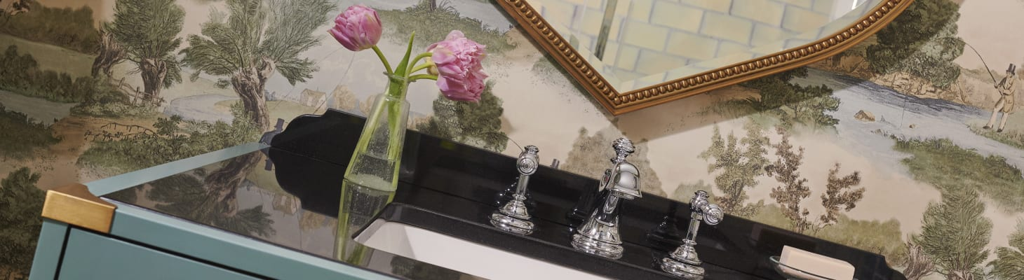 Woodland inspired wall paper, cream subway tiles, fresh towels and flowers this ensuite makes a perfect conference bedroom