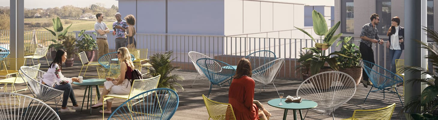 A bright and airy sociable roof top terrace with colourful tables and chairs making this a unique event venue.