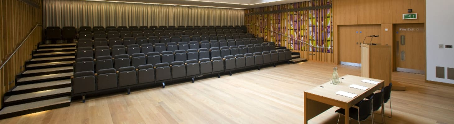The auditorium provides tiered retractable seating for up to 154 delegates, fully equipped with customisable lighting and audio-visual facilities. The flexibility of the auditorium allows you to create a bespoke environment and range of seating options which can to be used for meetings, lectures, performances and receptions. The open plan foyer creates an excellent space for guest registrations, exhibitions and refreshment breaks with the option of separating the foyer from the auditorium with a retractable wall. Direct access is also provided to the Dining Hall, Bar, and additional breakout rooms.