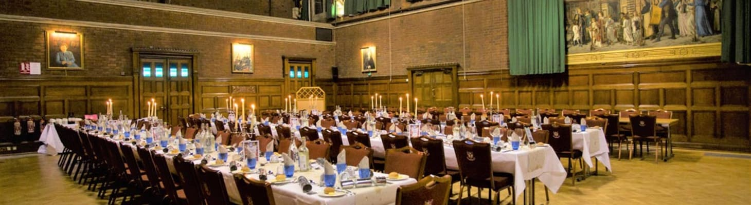 Beautiful Victorian Great Hall, traditional tall ceiling spacious room with long tables set up for private dining
