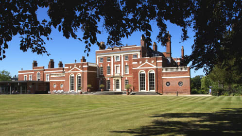 The lawn with the Grade 2 listed red brick, Hinxton Hall in the background, a conference centre in Cambridge.