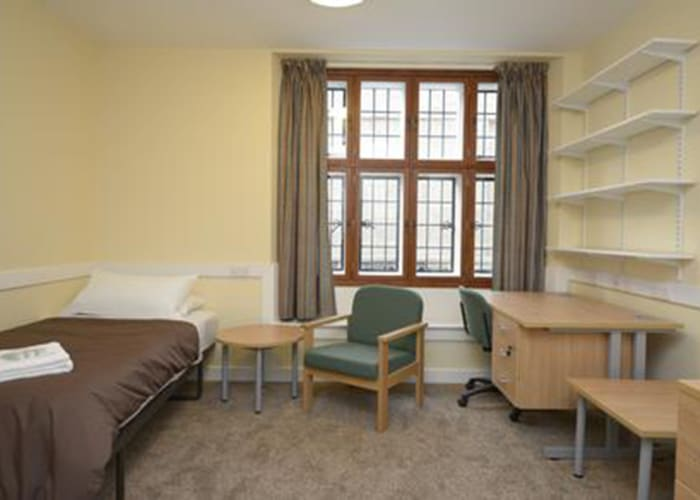 A standard bedroom, with single bed, desk and lounge chair, great accommodation for conference delegates.