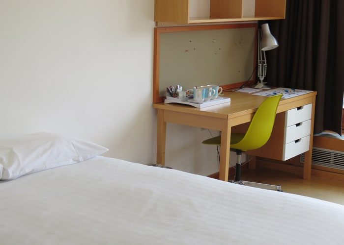 Double en suite bedroom £95+VAT  The nightly rate also includes tea and coffee making facilities, Spa toiletries, desk, wireless internet access and a full English and continental buffet breakfast.   The Harvey Court Building is located on West Road, a few minutes' walk to the city centre. Harvey Court was completed in 1962. It was designed by Professor Sir Leslie Martin, the Cambridge Professor of Architecture, and has won many prizes. It represents the then contemporary style, where materials of construction are fully exposed. The building was refurbished in 2011 to provide one hundred rooms with en suite facilities.