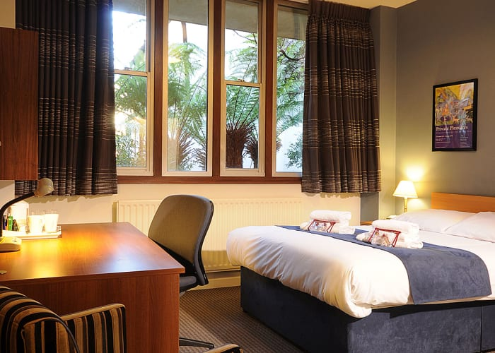 Double room with a private en suite bathroom with shower. Rooms are serviced daily during the week and towels and a vanity pack are provided.   Rooms have complimentary WiFi access. Hairdryers may be available on request from Porters' Lodge.