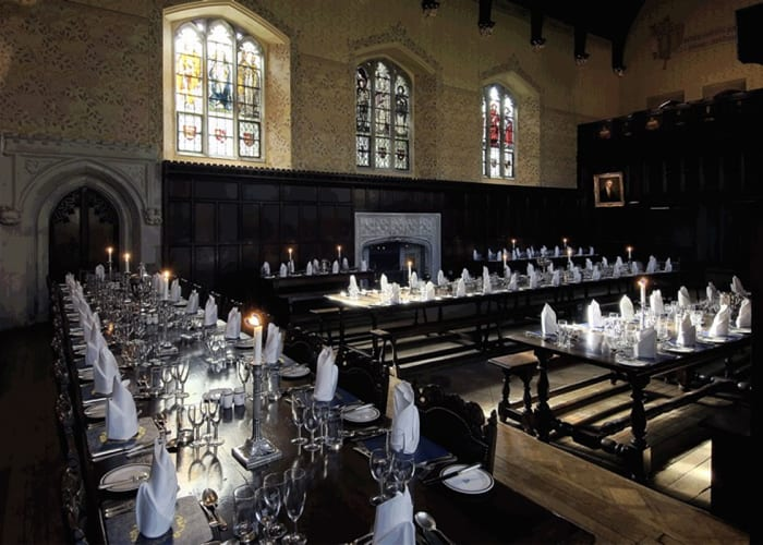 The dining hall at Peterhouse was completed in 1290 and, in continuous use by Fellows and students for over 700 years, is the oldest collegiate building in Cambridge, making it a unique venue for all occasions.  While the structure is medieval, the interior was redesigned in the late 19th century, with dark panelling and Masters' portraits, a minstrel's gallery and William Morris stained glass, stencilling and tiles combining to create a dramatic back-drop for grand dinners.  Capacity: Formal Dinner: 60-110