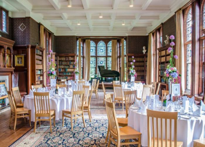 A beautiful country house-style library, this is one of the most traditional of our conference rooms. Its shelves are filled with the original books and there are beautiful views through the twelve arched stained glass windows onto the College grounds.