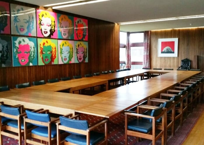 The collection of contemporary art, which adorns the walls of this formal dining room, facilitates the juxtaposition of traditional and contemporary culture giving this room an unusual ambience, making every event a memorable one.