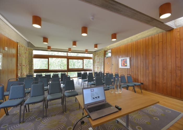 Located adjacent to the main College buildings, this wood panelled space is ideal as a syndicate or breakout room in conjunction with a larger conference. It is also used as an informal dining room.