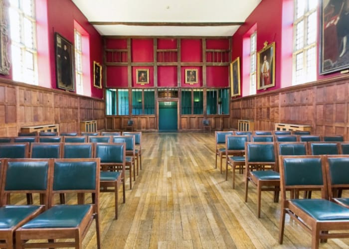 The Old Library, set theatre style. The room is full of character with wooden floors, panelling and beams. A flexible event space in Cambridge.