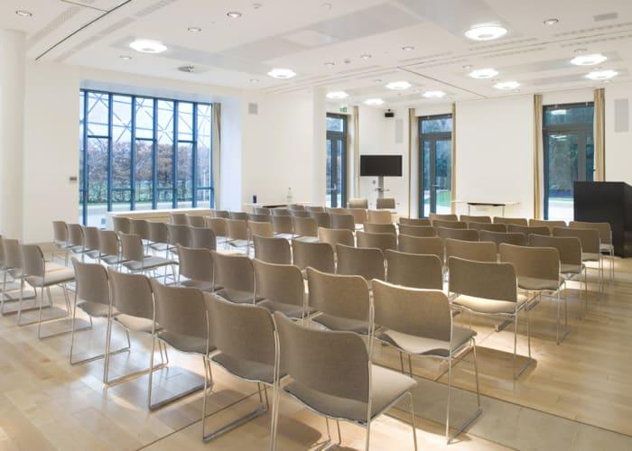 The Cavonius Centre is our most modern and flexible meeting room. A spacious and airy room, filled with natural light and modern art, the room layout can be customised to suit individual needs. There is also the option to sub-partition to allow for a main meeting room and up to three smaller syndicate rooms. The room comes with inbuilt AV equipment, black out curtains and zoned climate control. Hire of the Cavonius Centre also comes with complimentary use of the Stephen Hawing Building Lounge and Organiser's Office (the Office available during Summer Vacation only). With the added availability of on-site en suite accommodation during vacation periods, the Cavonius Centre provides everything that will ensure a successful conference.