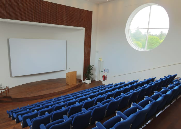 Situated in the Main Building, the Lecture Theatre features tiered seating and a raised stage area, ideal for addressing large groups. Capacity 100.