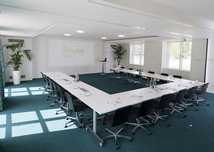 Situated in the Main Building, this new suite features views across Churchill College's grounds and external doors that open out onto a private patio area. The suite can also be divided into two smaller meeting rooms for further flexibility.