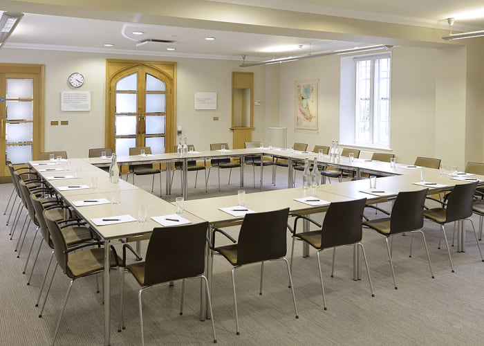 A versatile and spacious conference suite with climate control, natural light, built-in high specification audio-visual equipment, induction loops, wheelchair access and WiFi access. This is our largest room and is often combined with the use of the adjacent Newton Room for lunches and networking reception space.