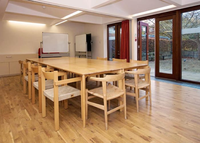 Located away from the main College buildings within the peaceful graduate accommodation area, this flexible space can be divided into two sections for syndicate work or opened into a single larger room. A sheltered terrace provides an additional area for delegates in the summer.