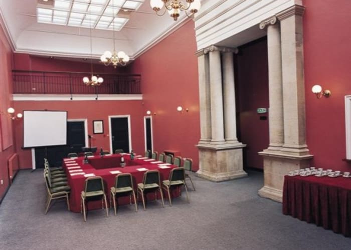 This bright and lofty room, formerly part of the University Museum of Classical Archaeology and adjacent to the Theatre, was refurbished in 2005.  With its own fully-equipped servery, it is an ideal break-out area for events taking place in the Theatre. As well as being used for serving a range of refreshments, it provides the perfect setting for promotional stands, posters and publicity materials.   The Lubbock Room can also be used independently for seminars and speaker meetings.  Capacity: Refreshments:  180 Theatre-style:  70 Boardroom-style:  30 Classroom-style:  25