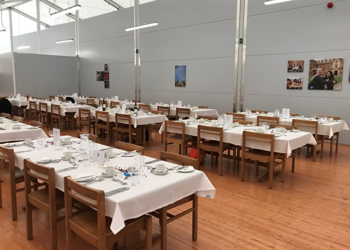 Modern marquee event space in Cambridge, spacious with tall ceiling and wooden flooring