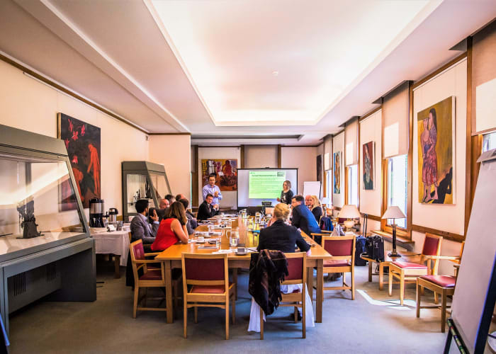 The combination room filled with delegates around a boardroom table, a great space for day meetings.