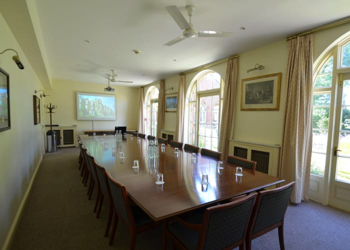 The Council Room is our traditional Cambridge meeting room and is still used for Hughes Hall Executive Council meetings. It has large French windows allowing views of the garden and a large wooden boardroom table, making it a great area for more formal meetings.