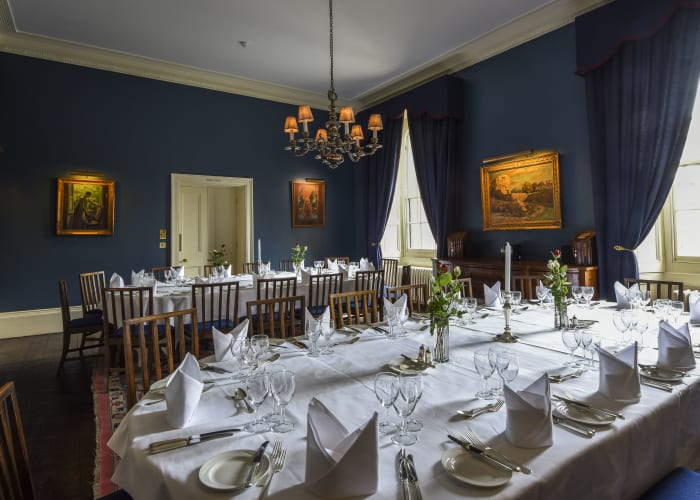 traditional dining room, with elegant teal walls and stunning fire place