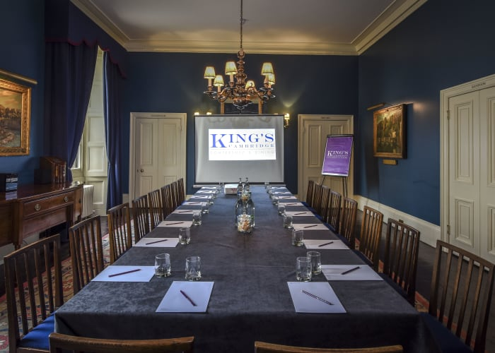 Traditional function room with teal walls and elegant long table
