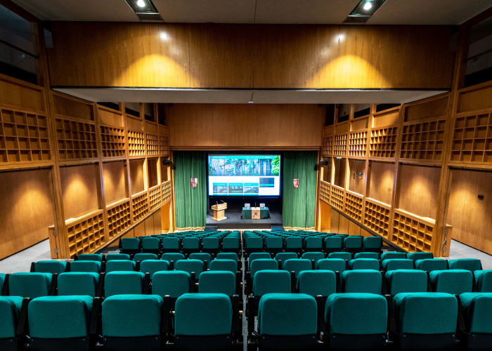 Situated in Lyon Court, this magnificent air-conditioned lecture theatre provides an ideal setting for conferences. It is equipped with the latest audio-visual facilities and a large staged area. At the press of a button the seating retracts into the wall providing a flat floored, flexible space.