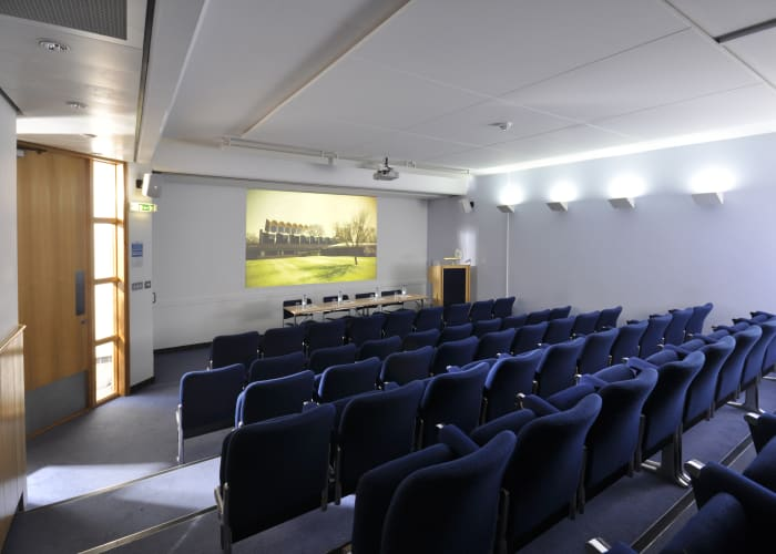 Part of the Wilson Court Conference Suite, the meeting rooms of the Suite can be used singly or as an integrated group. The Theatre seats up to 57 delegates in air-conditioned comfort. It has its own projection room and tiered seating with individual writing tablets. This small theatre offers a high quality audio-visual system, including data projector, laptop computer, DVD/CD/VHS player and a complete PA system.  As its main design feature is that of a theatre, this is the only room within the Suite which does not have natural light. It's easily accessible for disabled delegates with wheelchairs.