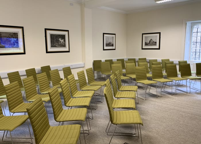 Harley Mason Room, set up theatre style facing the screen for a presentation. A self contained, ground floor meeting room, accessed from New Court.