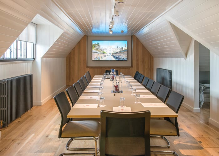 The Bain Room, located in the loft space of West Court, provides a comfortable and private setting for those looking for a unique meeting space.  The modern grey boardroom table with wood trim and executive fabric cantilever chairs will seat up to 18 delegates. It is also equipped with a wall-mounted high resolution digital TV screen for presentations.