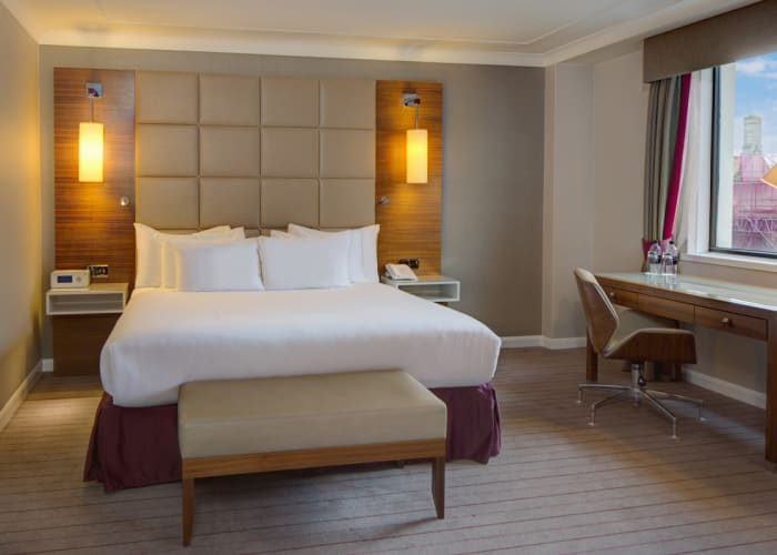A bright and spacious bedroom with a king bed at Hilton Cambridge City Centre, ideal conference accommodation.