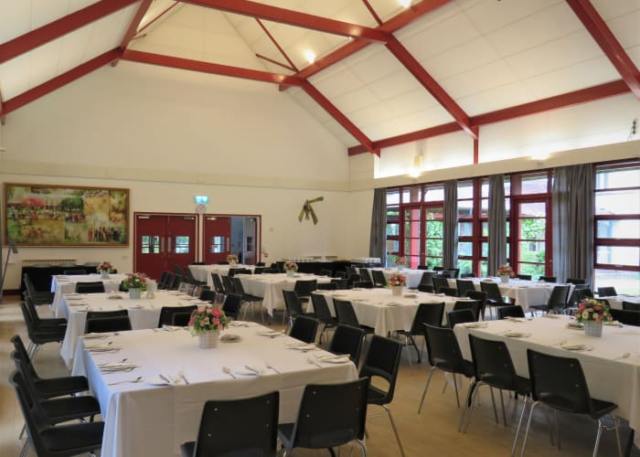 Lee Hall at Wolfson College, a large spacious room with high ceilings. An ideal events venue in Cambridge.