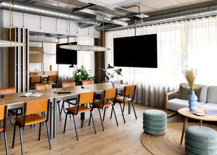 A large multi functional working space with a boardroom layout, TV screen and AV fitted great for small meetings at Turing Locke, Cambridge.