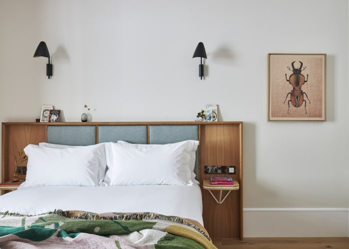 With a wooden paneled headboard this cosy bedroom with white fresh lined is perfect for conference accommodation