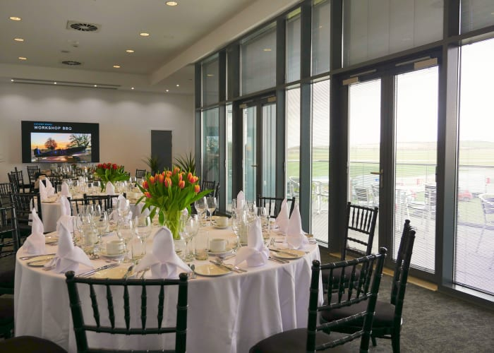 Our Airside Suite is light & specious with floor to ceiling windows & private balcony which offers your guests stunning views over our runway and stunning Cambridge countryside during your dining experience. Our AirSide Suite can be dressed to your personal preference with event lighting to add to your atmosphere.