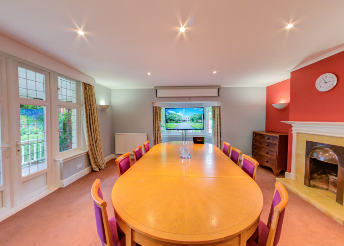 Meeting room in Plommer House able to seat up to 10 people boardroom style.