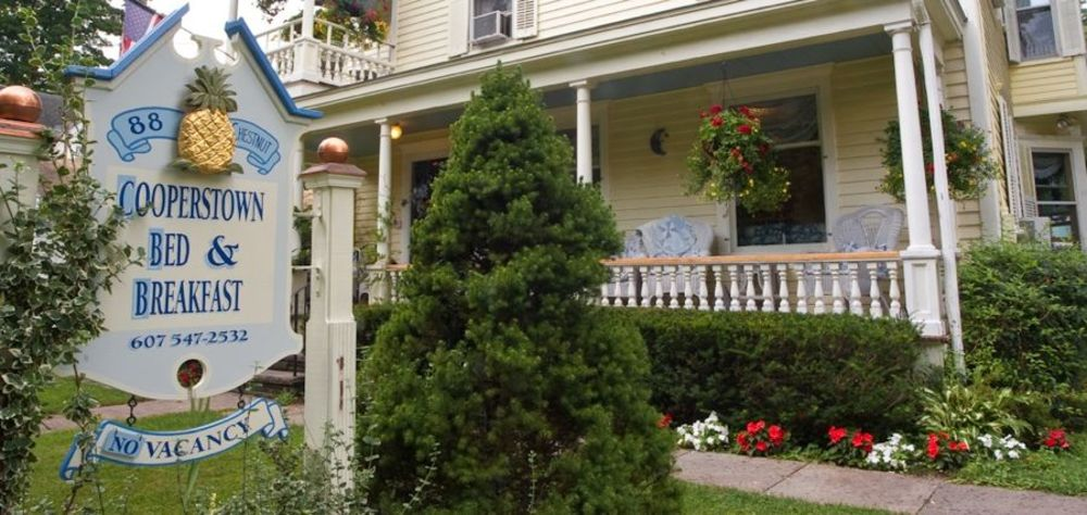 Cooperstown Bed and Breakfast sign and porch Summer