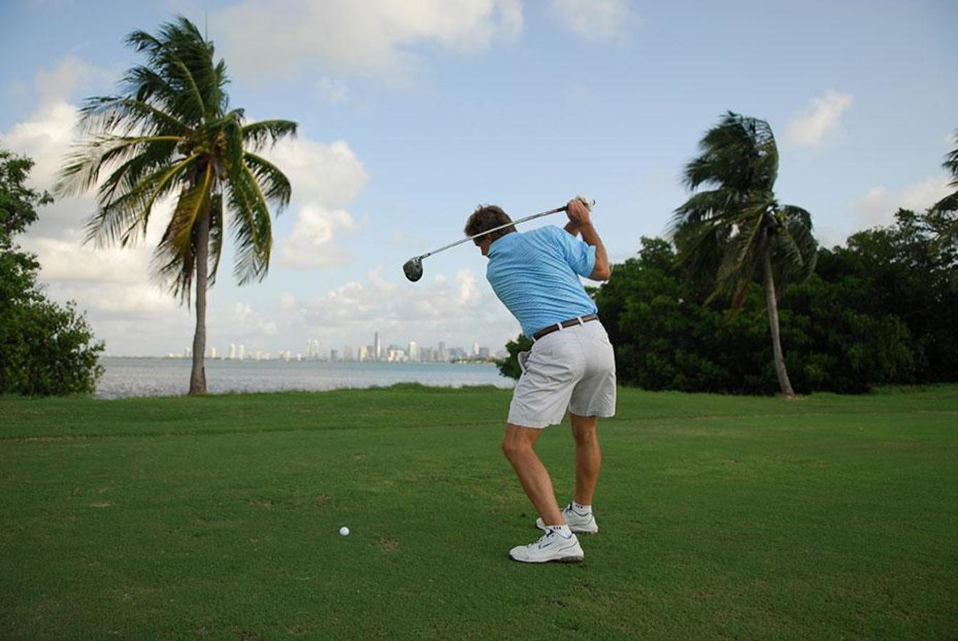Teeing off at Crandon Golf with Downtown Miami across the bay