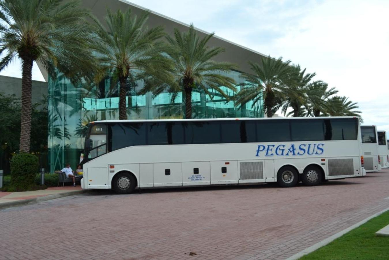 5 of our 25 motorcoach buses outside the Mall at Millenia while one of our large groups is on a Pega