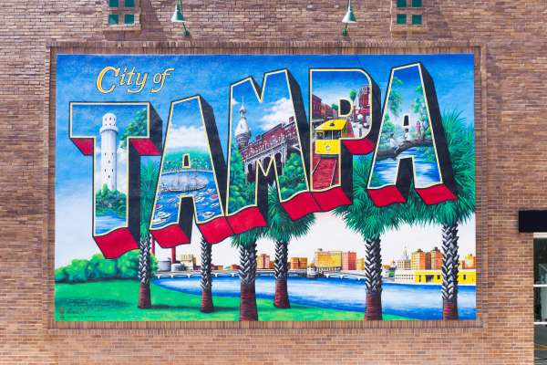 The Tampa Postcard Mural on the brick facade of a building in Downtown Tampa.