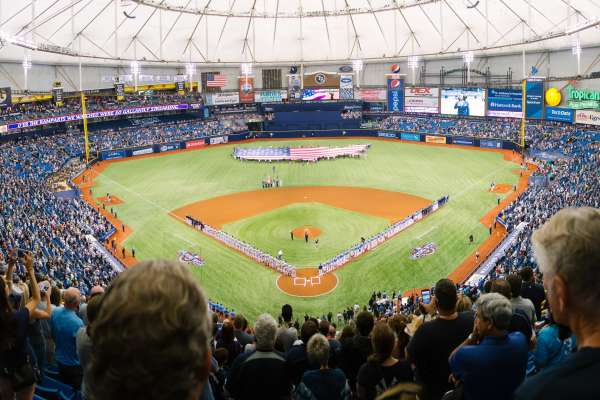 Fans looking over home plate at Tropicana Field during the National Anthem of the Tampa Bay Rays game