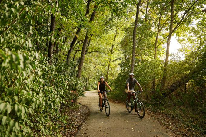 Couple biking through the forest