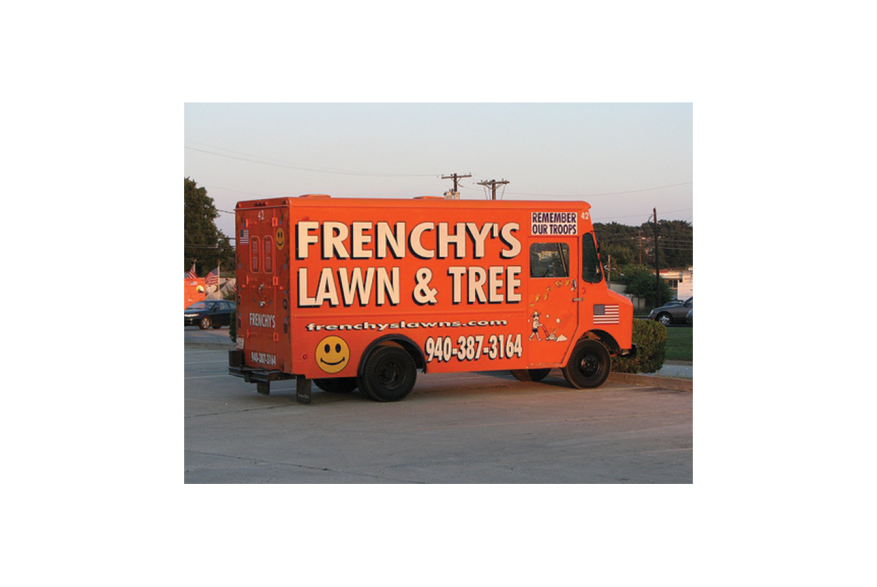"""And orange truck that reads """"Frenchy's Lawn & Tree"""""""