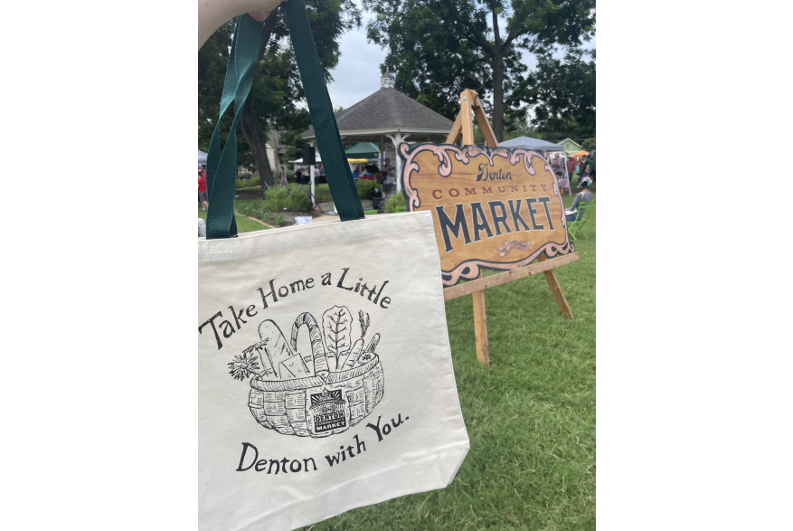 """A canvas bag reading """"Take Home a Little Denton with You"""" at Denton Community Market"""