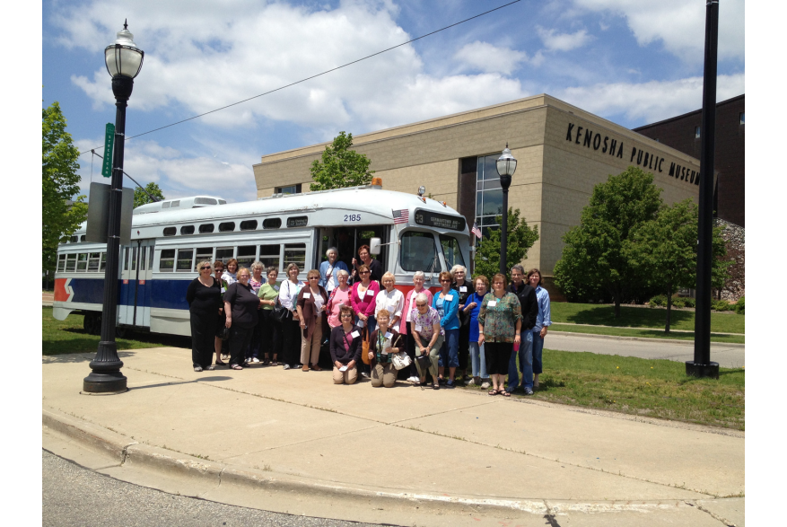 group posing outside Electric Streetcar