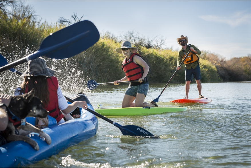 People playing in the Salt River while kayaking and paddle boarding