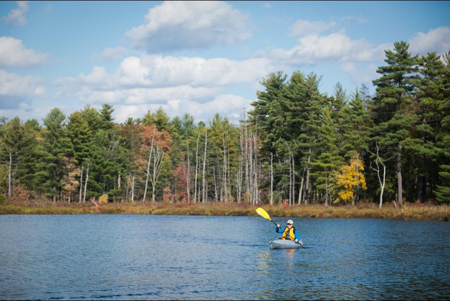 Lady Kayaking in the Pocono Mountains Lake