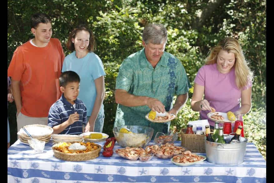 Family enjoying seafood picnic