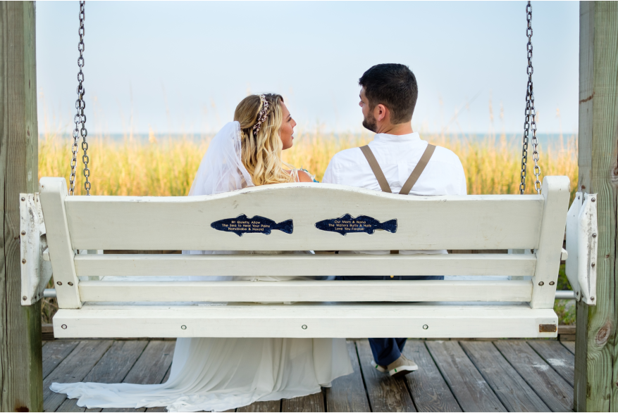 Wedding Couple on Bench Swing on Carolina Beach Boardwalk
