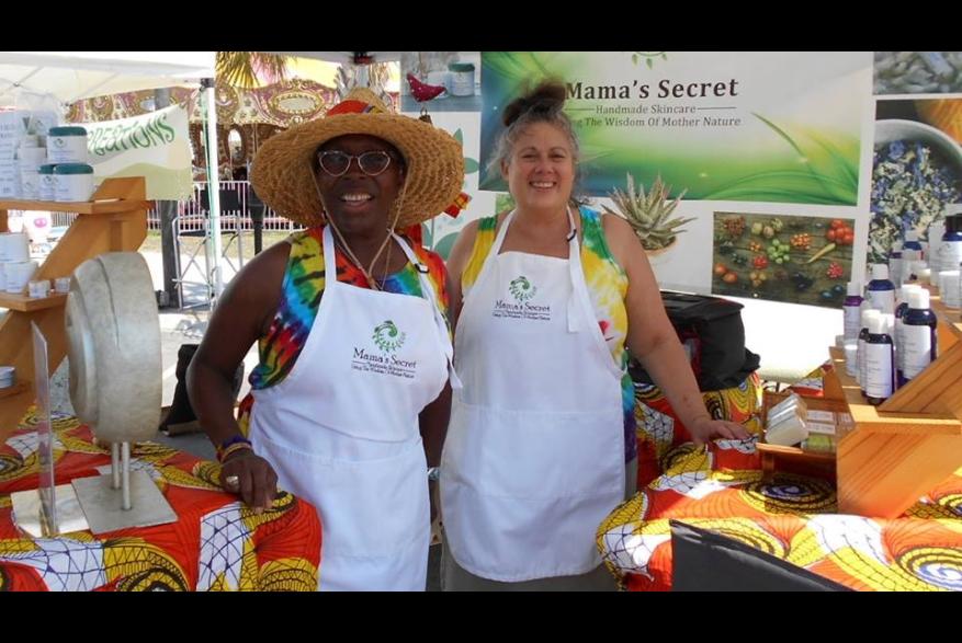 Two women in tent at Carolina Beach Street Arts Festival