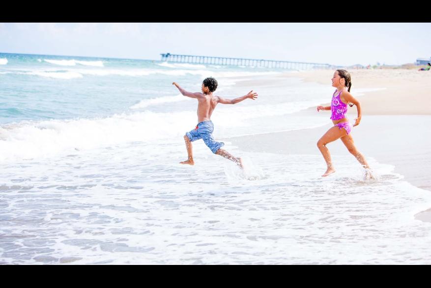 Kids Playing in Ocean at Kure Beach