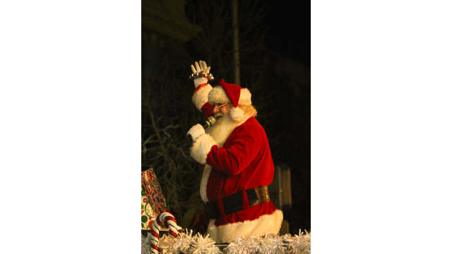 Santa waiving during the Athens Parade of Lights
